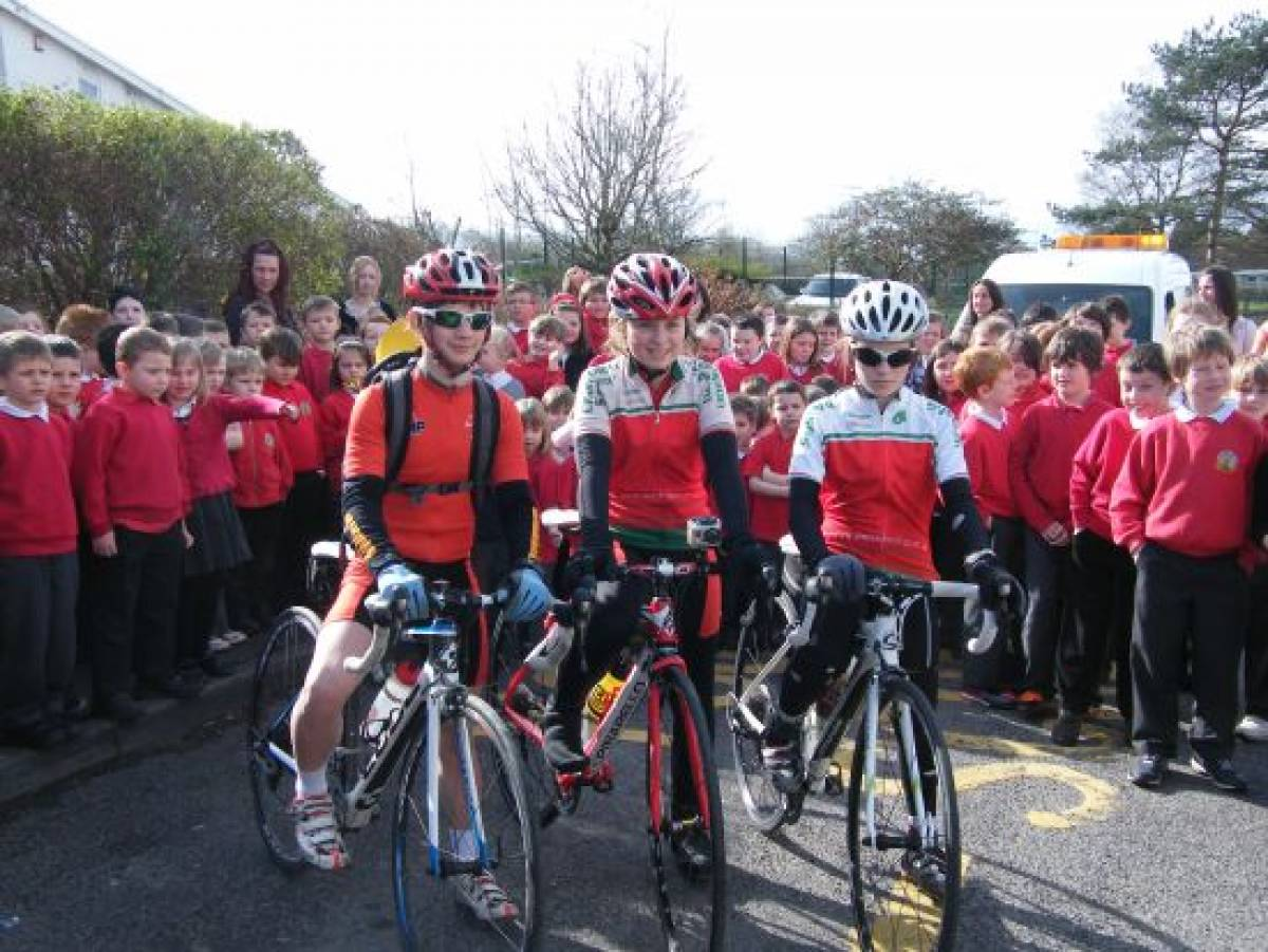 Cyclists carry the Carmarthenshire OIympic Torch
