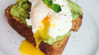 Poached eggs and smashed avocado on toast
