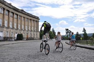 Cyclists passing the Royal Crescent during Sky Ride 2010