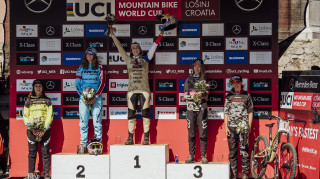Podium shot from the first round of the first downhill round of the World Cup in Losinj Croatia, Rachel Atherton, Myriam Nicole, Tahnee Seagrave