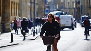 A women cycling in Cambridge