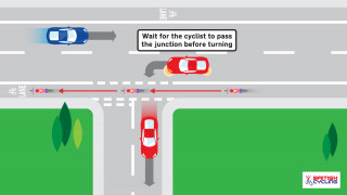 A car gives way before turning left
