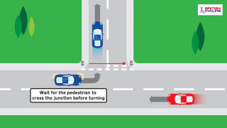 Car gives way to pedestrian