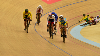 Katie Marchant in the UEC European Track Championships keirin, while teammate Victoria Williamson crashes
