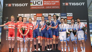 Ed Clancy, Steven Burke, Ollie Wood and Kian Emadi celebrate winning team pursuit gold at the Tissot UCI Track Cycling World Cup