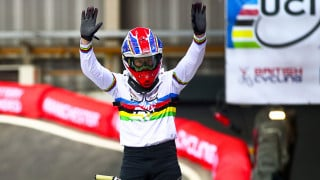 Liam Phillips celebrates winning the UCI BMX Supercross World Cup round in Manchester - while wearing his world champion rainbow stripes
