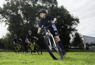 Child taking part in HSBC UK Go-Ride at school