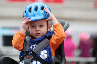 Kid in child seat at a HSBC UK Let's Ride event.