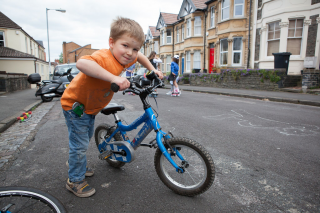 Children playing out on their street and cycling