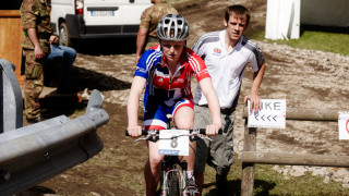 Phil Dixon follows Annie Last to the start line of the 2008 junior world championhips.