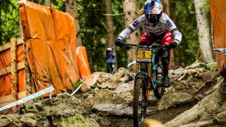 Britain's Rachel Atherton made history as she won a tenth successive UCI Mountain Bike Downhill World Cup with victory in Leogang on Sunday.