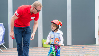 Sir Chris Hoy with a young rider at HSBC UK City Ride in Birmingham