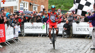 Peter Kennaugh celebrates solo victory at the 2013 Lincoln Grand Prix.