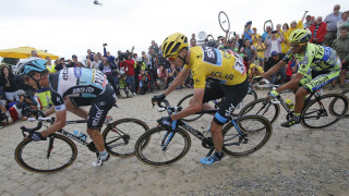 Chris Froome on the cobbles behind eventual stage winner Tony Martin.