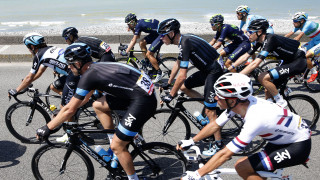 Chris Froome surrounded by Team Sky on the road to Le Havre