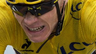 Chris Froome grimaces as he crosses the line to complete stage 19