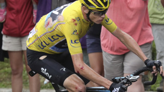 Chris Froome crashed in treacherous conditions but recovered to keep his grip on the yellow jersey.