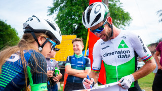 Mark Cavendish signs something for a young fan at the British National Championships.