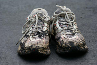 Image of muddy running shoes