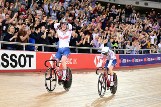 Laura Kenny and Katie Archibald celebrate after winning gold in the madison during the Tissot UCI Track Cycling World Cup in London.