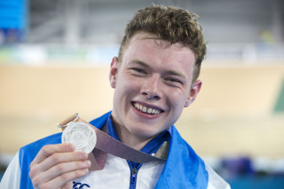 Jack Carlin with his silver medal